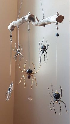 This original OOAK piece was handcrafted using 5 individual beaded spiders each with their own personality. A gorgeous and gnarly piece of Driftwood from a flooded river bank was used as the hanger. Suspended with fishing line and beads, this is sure to be an admired and unique