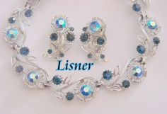 This lovely designer signed Lisner demi parure, presented by JoysShop for consideration, features a matching necklace and earrings.  The silvertone floral motif links are s... #vintage #jewelry #voguet