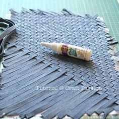 Weave strips of denim to make fabric for a purse, bag or