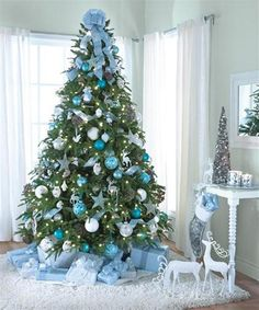 But if you truly want to stand out, we'd suggest you go for a blue Christmas tree this year. we've gathered a list of blue Christmas tree decoration ideas. Beautiful Christmas Trees, Colorful Christmas Tree, Christmas Tree Themes, Xmas Tree, Christmas Tree Decorations, Christmas Tree Ornaments, Frozen Christmas Tree, Silver Decorations, Christmas Photos