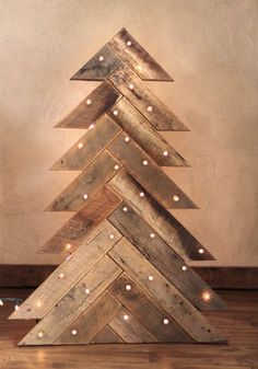Items similar to Barn Wood Christmas Tree - Herringbone Pattern - Wood Tree - Christmas Lights - Rustic Christmas Tree - Reclaimed wood on Etsy Pallet Christmas Tree, Christmas Projects, Christmas Lights, Christmas Decorations, Pallet Tree, Diy Christmas, Xmas Trees, Holiday Decorating, Pallet Porch