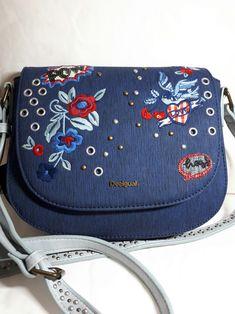 f9ca11ff43854 Desigual bols denim flower varsovia Blue Crossbody with embroidered  patchesstuds and sequins.