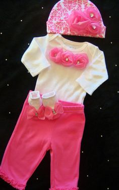 NEWBORN baby girl take home outfit complete with pink satin rosette onesie, matching pants, pink damask hat and socks. $40.00, via Etsy.