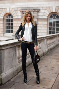 Love the feminine blouse with the leather jacket!