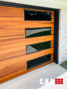 Accents Woodtones (shown in Cedar) by C.H.I. Overhead Doors are the most realistic faux wood garage doors available. See for yourself -  order your free color samples today! Credit: Greg Price Faux Wood Garage Door, Garage Door Windows, Windows And Doors, Black Window Frames, Black Windows, Types Of Insulation, Window Types, Cedar Siding, Mid Century Modern Decor