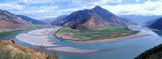 The first turn of the Yangtze at Shigu (石鼓) in Yunnan Province, where the river turns 180 degrees from south- to north-bound. The Yangtze River, or Chang Jiang is the longest river in Asia, and the third longest in the world. It flows for 6,418 kilometres from the glaciers on the Qinghai-Tibet Plateau in Qinghai eastward across southwest, central and eastern China before emptying into the East China Sea at Shanghai. It is also one of the biggest rivers by discharge volume in the world.