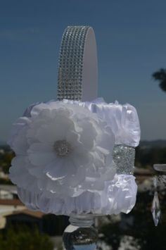 Flower Girl basket-White ruffle basket with silver sparkle -Rhinestone handle and white peony. $35.00, via Etsy.
