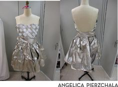 Here I made a dress out of newspaper and spray paint. I cut individual strips and weaved the corset attached it to the skirt and added a belt.  Show in Bloomington's Trashion Refashion Show. Designed by Angelica Pierzchala
