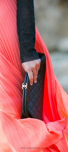 Style - essential details - Chanel black quilted clutch and flowing coral maxi skirt