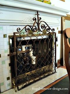 Old iron gate repurosed into a fireplace screen