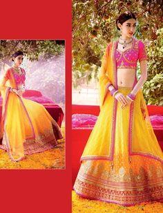 Exotic Viscose Georgette Lehenga With Yellow And Pink Combination $197.46 #weddinglehenga #bridallehenga #partywearlehenga #festivallehenga #designerlehenga #fashionumang