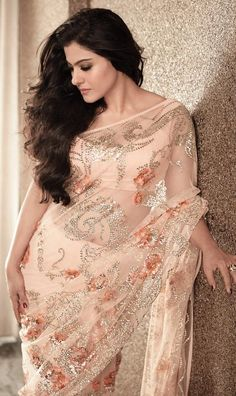 Kajol in a peach colour saree or sari and blouse  to get more hd and latest photo click here http://picchike.blogspot.com/