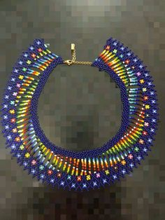 Jaw dropping colours weaved into this beautiful collar neckless! African Beads Necklace, Seed Bead Necklace, Seed Bead Jewelry, Beaded Earrings, Beaded Bracelets, Beaded Jewelry Patterns, Fabric Jewelry, Handmade Necklaces, Handmade Jewelry