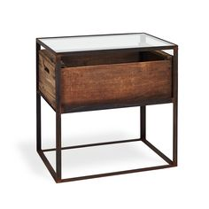 Exclusively at ABC, a vintage wine crate sourced from California creates a rustic vibe amid the beauty of glass and iron. Hand-wrought from a recycled iron frame, its distressed patina adds a natural red-hued finish. Beautiful when mixed with more modern pieces. Also available as a coffee table.