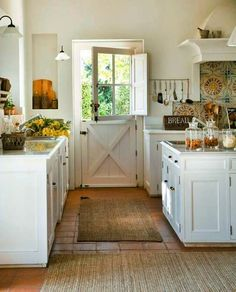 I grew up with a Dutch door...would love one again and I happen to like this kitchen, too.