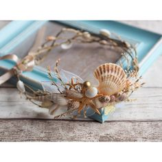 seashell headpiece,seashell headband,seashell hair... ❤ liked on Polyvore featuring accessories, hair accessories, artificial flower garland, flower hair comb, headband hair accessories, flower garland headband and flower garland