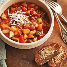 Ratatouille with Parmesan Toast --This traditional French dish is loaded with fresh vegetables including eggplant, peppers, and summer squash. Our slow cooker version adds protein-rich beans and a sprinkling of fresh basil on top. Crock Pot Slow Cooker, Crock Pot Cooking, Slow Cooker Recipes, Crockpot Recipes, Soup Recipes, Cooking Recipes, Bhg Recipes, Recipies, Crock Pots