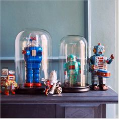tin robots and cloche bell jars display