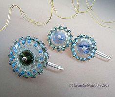 Manuela Wutschke • Glass Artist: Smokey Eyes for the Ear Carol: reminds me of jellyfish...would like jellyfish earrings!