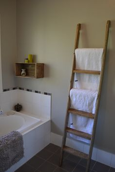 Rustic Ladder Towel Rail!     Ladder can be attached to your wall in a few ways...we have attached it with a screw through left side of ladder into a wooden stud found in the wall and silicon rubber grips to the bottom of the legs to avoid any slipping on the tiles.