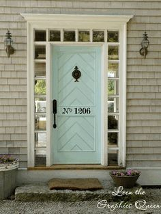 I love the chevron design on this door and the little windows surrounding it - shame its lacking a letterbox though!
