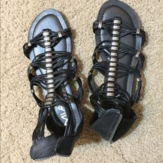 Mia Black Gladiator Sandals Cute gladiator sandals bought from Famous Footwear. Only worn once. Note the white chip in the top left sandal. Could easily be masked. MIA Shoes Sandals