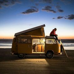 VW bay window camper at the beach