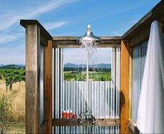 corrugated tin bathroom | Outdoor shower with corrugated tin walls at Carneros ... | Cabin Cu...