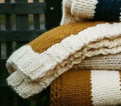 Knit blankets in pretty colors.