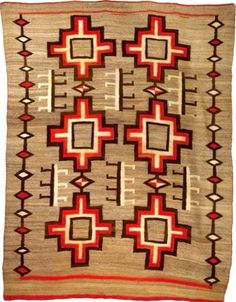 This Navajo textile has traditional elements of red, brown, and cream colors with a geometric-like pattern. It is from a collectors website. (http://www.icollector.com/Navajo-Rug_i11800280)