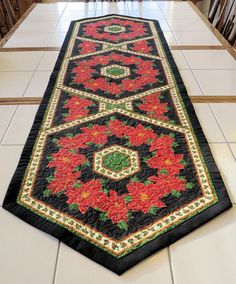 Quilted Holiday Table Runner poinsettia hexagon red black