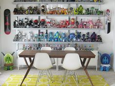 """""""Eames Molded Plastic Chairs offer a perfect vantage point for viewing this colorful collection of toys."""""""
