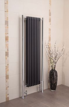 Apollo Bologna Vertical modern contemporary variation of roma steel column radiators modern contemporary column radiator suitable for modern living areas unique design in black textured metallic - with a chrome, nickel or gold finish.  It comes complete with a 10 year guarantee. Prices from £675.00!