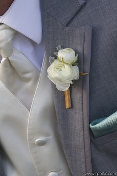 The boutonnieres and corsages will be white ranunculus and gray dusty miller…