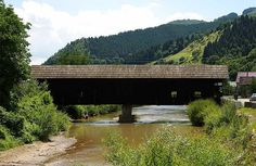 """""""The Bridge of Love"""" or the covered bridge in Cosbuc village, Bistrita Nasaud county was built in 1778 by Italian border guards and rebuilt in 1937. Monument of architecture, it is considered the last of its kind in Europe"""