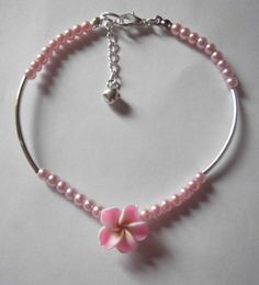 Handmade Jewellery - Anklet 2.99. A gift idea by flossies emporium found on www.MyOwnCreation.co.uk: 4mm glass pearl beadsinterspaced with tubular silver plated spacers.centre piece of 15mm fimo flower bead in shades of  pinkapprox 9.5