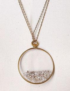 DIAMOND SHAKER NECKLACE. Crystal locket filled with loose diamonds, saphires or rubies. $3,000.