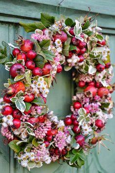 Rosehip, berries and flowers wreath