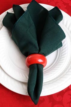 Napkin rings are some of the cutest home decor elements that usually left out. But that's a big mistake! Napkin rings can bring your home the spirit of the holiday and leave a smile on your guests' faces. Visit Glaminati.com for more inspirational ideas of Christmas napkin rings! #glaminati #christmasdecor #christmascenterpiece #christmasnapkinring #christmasdecoration #christmastabledecor #xmasdecor