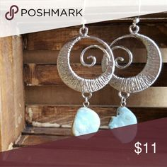 Rolling Wave Silver in color spiral wave with blue shell bead on the bottom. Jewelry Earrings