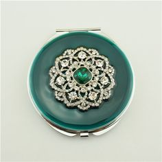 Flower series personalised pocket mirror/retro compact mirror This crystal flower compact mirror is a perfect gift for lady. It is covered with peacock blue enamel glaze and mounted with bling-bling crystals and elegant pearls.