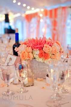 Pink and Orange wedding centerpiece ///// {Credit: Stems}