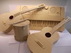 Just moved house and wondering what to do with you leftover cardboard boxes? Instead of throwing them away, recycle your moving boxes in something cool. Cardboard Sculpture, Cardboard Paper, Cardboard Crafts, Paper Crafts, Instrument Craft, Musical Instruments, Art For Kids, Crafts For Kids, Music Theme Birthday