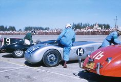 Start of 1955 Sebring 12 Hour GP The Le Mans style start from the 1955 Sebring 12 Hour GP. The #16 Jaguar XK120 was driven by Fred Dagavar and Al Garz finished 46th. The #14 Jaguar C-type was driven by Russ Boss and Jake Kaplan and finished 12th. On the far left is the winning Jaguar D-type of Mike Hawthorn and Phil Waters. In the photo the legendary English driver Mike Hawthorn is getting into the D-type. Paul Rainville photo.