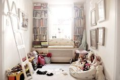 bookshelves and a bench under the window, perfect use of the space!