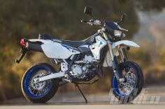 """""""Missing from Suzuki's lineup for three years, the DR-Z400SM returned for 2013. We're stoked to have it back, as it's the only street-legal, lightweight, small-displacement, 17-inch-wheeled supermoto still available in the US."""""""