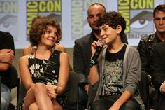 Bright futures! (L-R) GOTHAM stars Camren Bicondova and David Mazouz -- aka Selina Kyle/future Catwoman and Bruce Wayne/future Batman -- during the panel portion of the Warner Bros. Television Presents a Night of DC Entertainment event program Saturday, July 26, in Hall H at Comic-Con 2014. #WBSDCC
