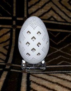 Drilled, carved goose egg