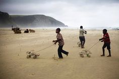 Boys with hand-made wire cars, Coffee Bay, Wild Coast, South Africa. ph. Lavonne Bosman
