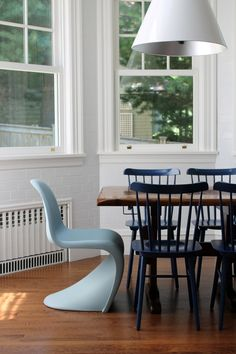 Dining room design with white brick walls and mix & match chairs | Emily C Butler